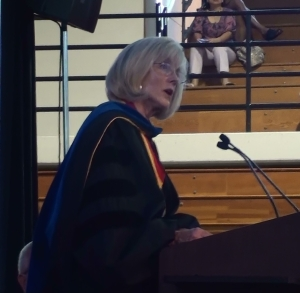 Dr. Roberta Lessor delivering annual Aims of Education address.