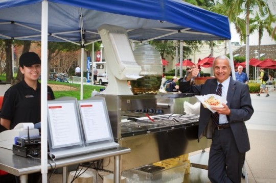 The new Doti's Dog's cart gets the presidential stamp of approval from President Jim Doti.