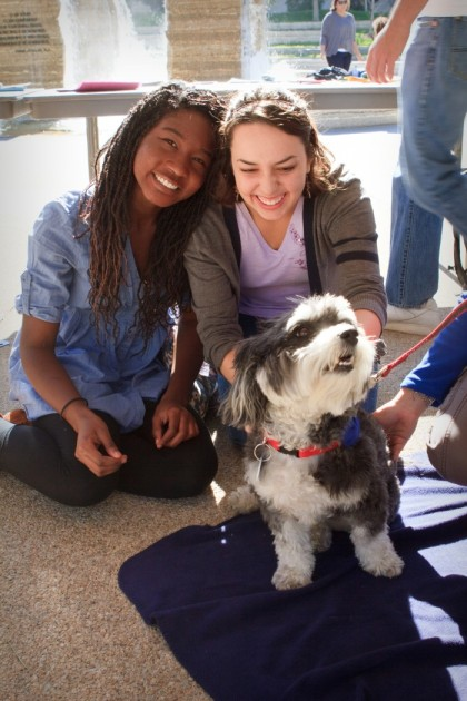 Nimah Gobir '15, left, and Savannah Wood '15, take a break with one of the furry friends.