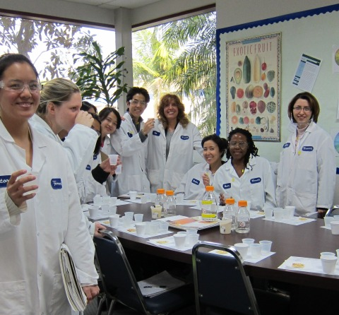 Food science students are treated to a product tasting during an industry tour of Firmenich this week. Standing fourth from right is program alumna Sue Polen  (M.S. '04), plant manager at Firmenich.